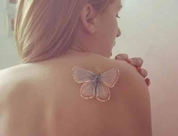 tattoo de mariposa en la espalda