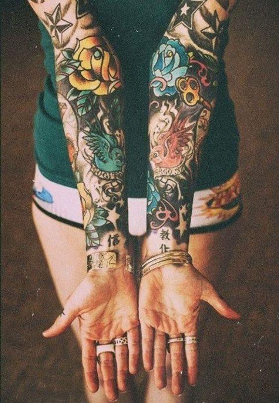 2 brazos tatuaje