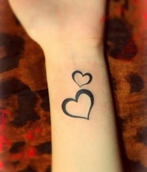 pequeño corazon tattoo
