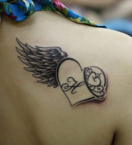corazon alas y coronas tattoo