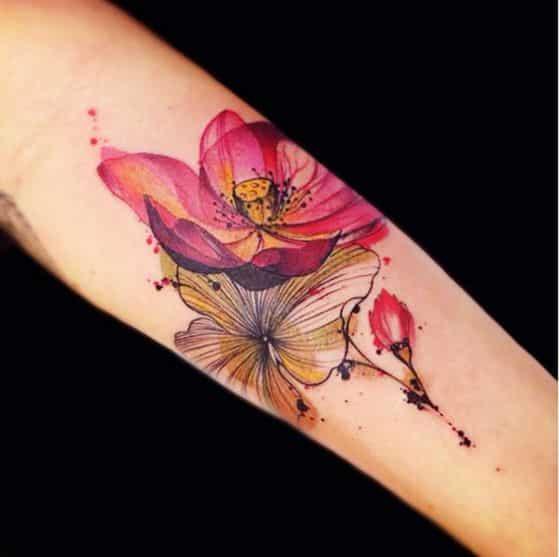 flores floreciendo tatuaje