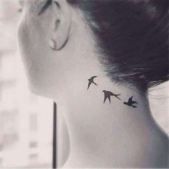 pajaros volando tattoo