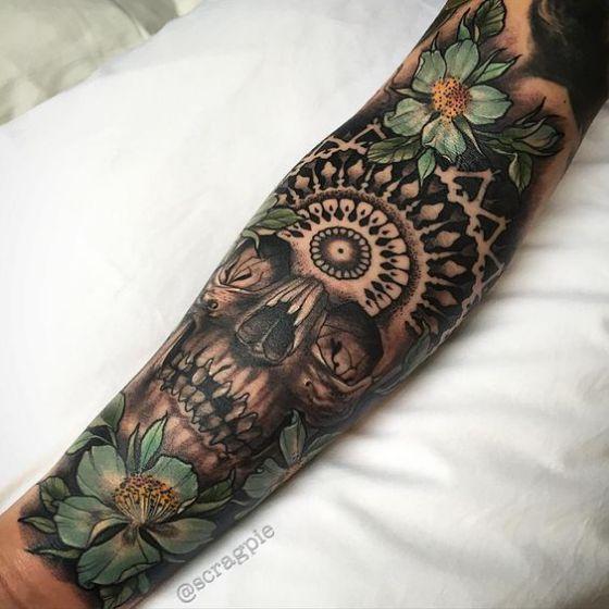 tatuaje calaveras con flores