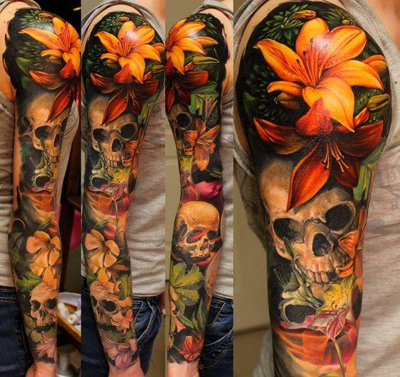 flores y calaveras tatuaje