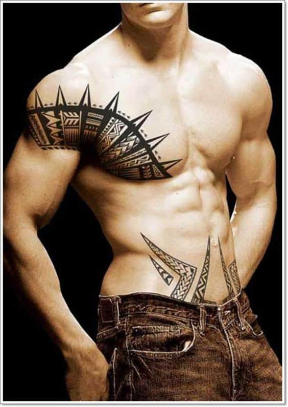 abdomen bajo tatuado hombres 1 - Tatuajes en el abdomen con diferentes diseños y tamaños