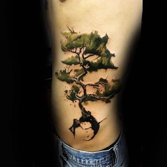 tatuaje arbol bonsai hombres costillas
