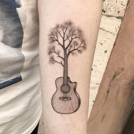 ideas para tatuar guitarras acusticas 1 - Tatuajes de guitarras eléctricas y acústicas amor por la música en la piel