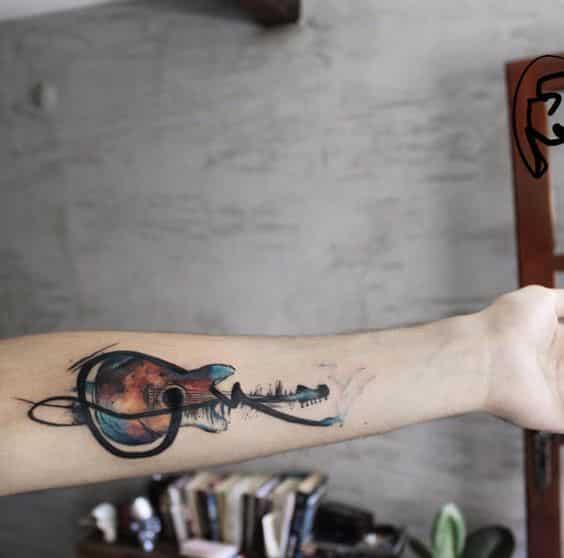 pequeñas guitarras en la piel 5 - Tatuajes de guitarras eléctricas y acústicas amor por la música en la piel